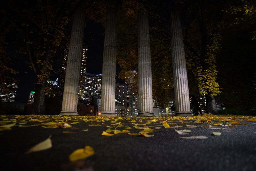 4 granite pillars stand silently watching over the Seattle Skyline