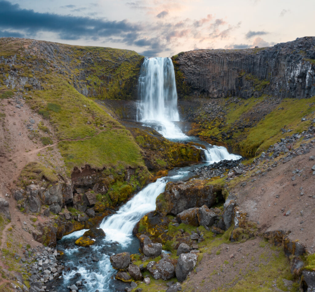 Svöðufoss is a gorgeous waterfall in west Iceland hidden down a dirt road past a small farm.