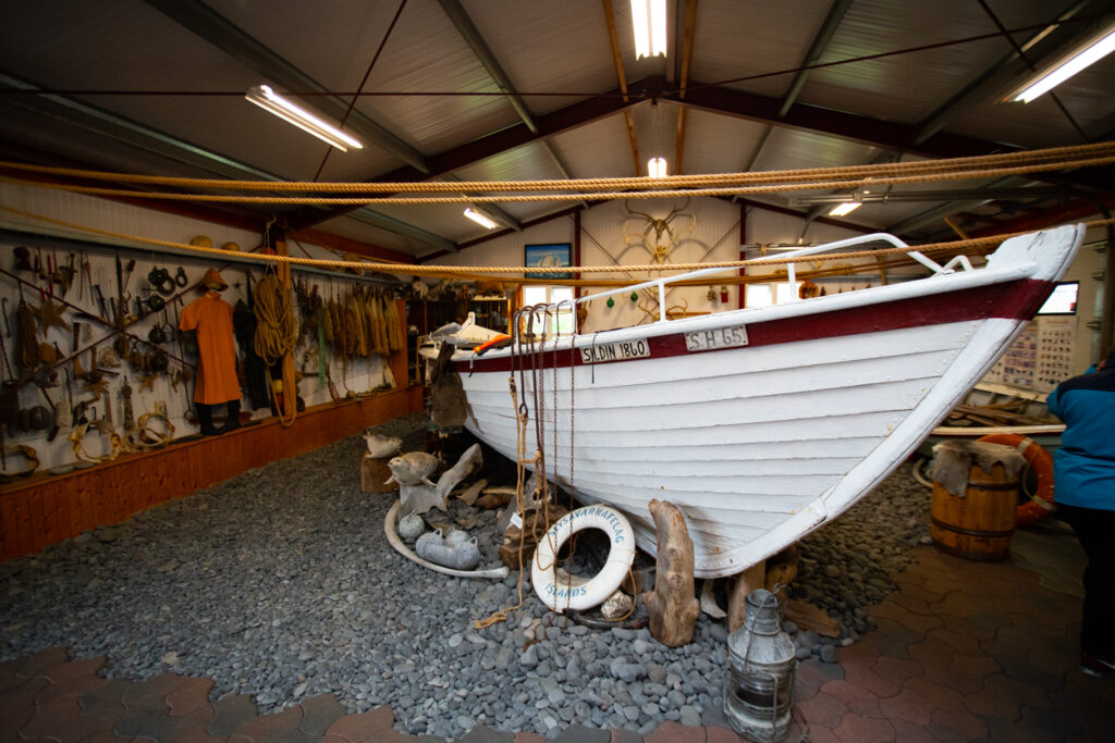 A shark fishing boat inside of the Bjarnarhöfn Shark Museum.